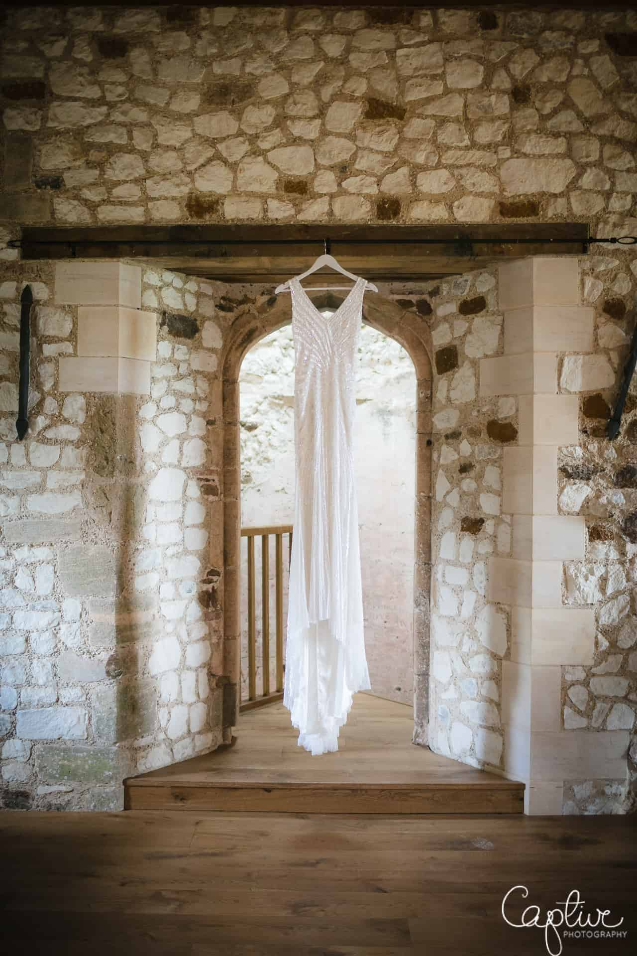 Wedding dress photo at pentney Abbey Estate